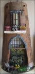 Tegola in Rilievo, facciata con carretto, uva e vendemmia