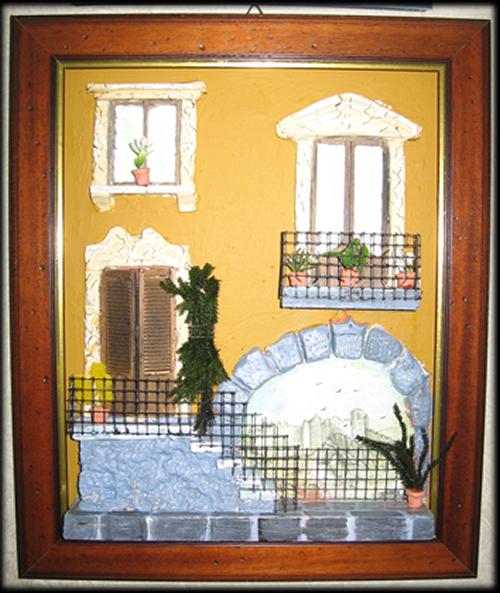 quadro in rilievo, facciata con scalinata e arco