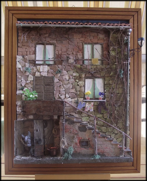 Quadro in rilievo, facciata con pietre e asinello