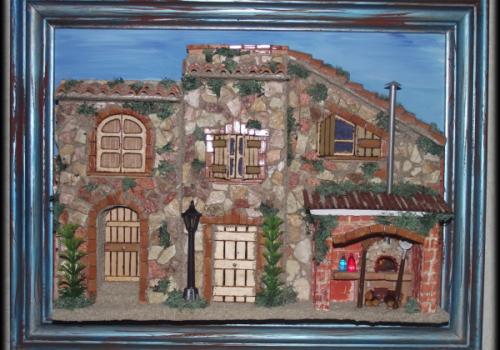 Quadro in rilievo, facciata in pietra con forno a legna