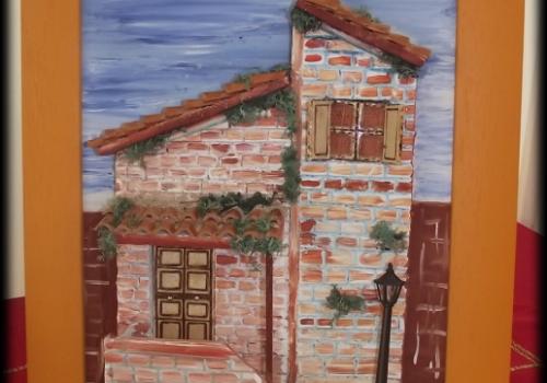 Quadro in rilievo, facciata con mattoni a vista