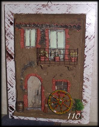 Quadro in rilievo, facciata con ruota carretto siciliano