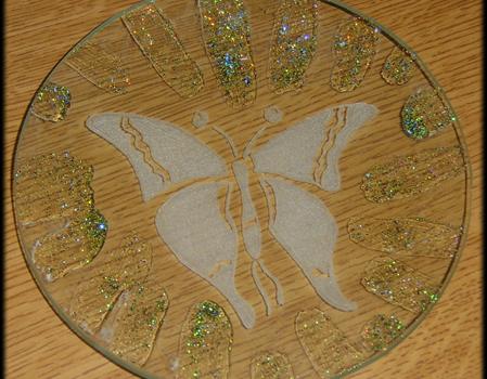 Incisione su vetro di una farfalla