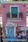 quadro in rilievo, realizzato in ceramica, rappresentazione di una bar, pasticceria