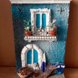 quadro in rilievo in ceramica fredda pescatore